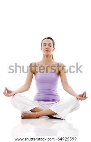 Young woman practicing yoga on white background studio - stock photo