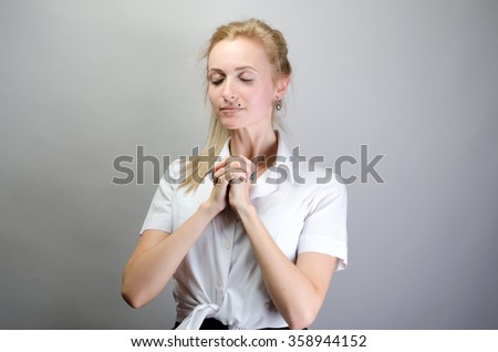 young woman praying holding clasp hands together, concept of girl problem - stock photo