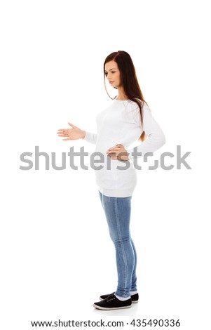 Young woman pregnant- unpleasant surprise - stock photo