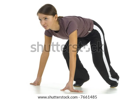 Young woman preparing to race. White background. Side view, whole body - stock photo