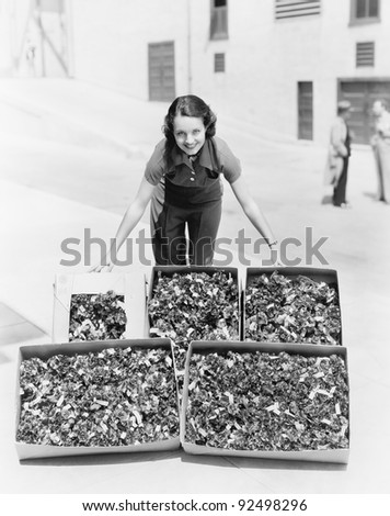 Young woman presenting poppies in a box - stock photo