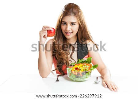 Young woman pretty attractive presenting and eating salad. Portrait of beautiful smiling and happy mixed Asian brunette woman enjoying a healthy salad and cherry tomatoes snack