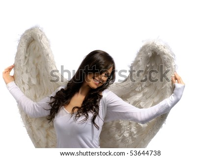 Young woman proudly holding her angel wings isolated on white