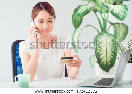 Young woman purchasing product online - stock photo