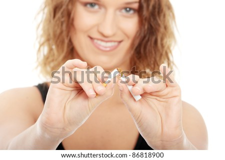 Young woman quiting smoking, isolated on white - focus on hand - stock photo