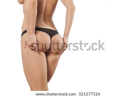 young woman raises her buttocks with her hands - stock photo