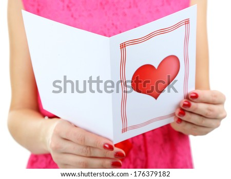 Young woman read Valentine card close up