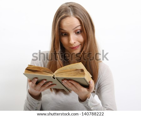 Young woman reading a book, isolated - stock photo