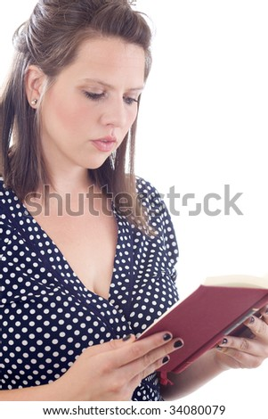 Young woman reading a book; isolated on a white background. - stock photo