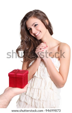 Young woman receiving a red box - stock photo