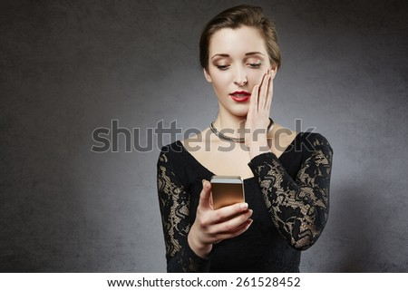 Young woman receiving bad news - stock photo