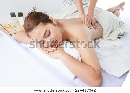 Young woman receiving professional massage.