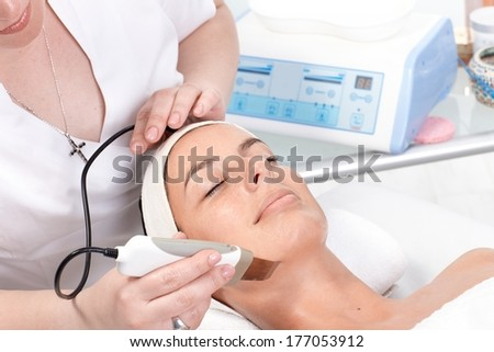 Young woman receiving skin rejuvenating treatment at beauty saloon. - stock photo