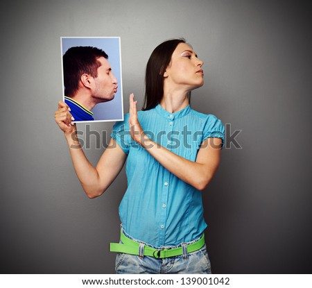young woman refusing of kissing men - stock photo