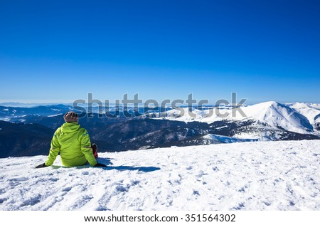 Young Woman relax in mountains during winter hiking