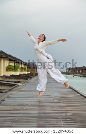 young woman relax on cloudy summer day and bad weather - stock photo
