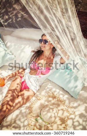Young woman relaxing at summer lounge - stock photo