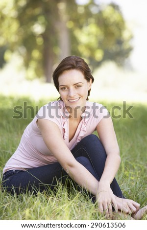 Young Woman Relaxing In Countryside