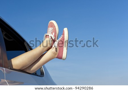 Young woman relaxing in her car, copy space