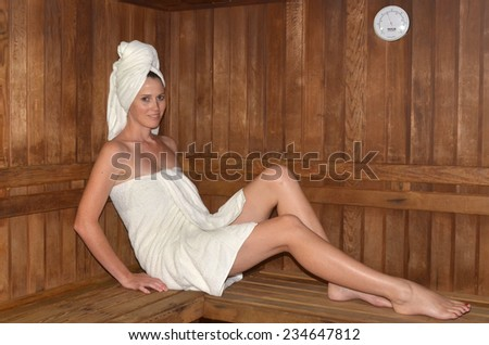 Young woman relaxing in spa.Healthcare and beauty concept. copyspace - stock photo