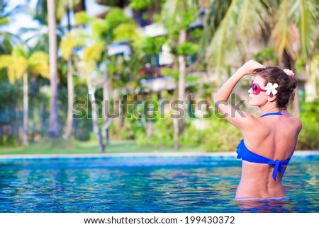 young woman relaxing in spa pool - stock photo