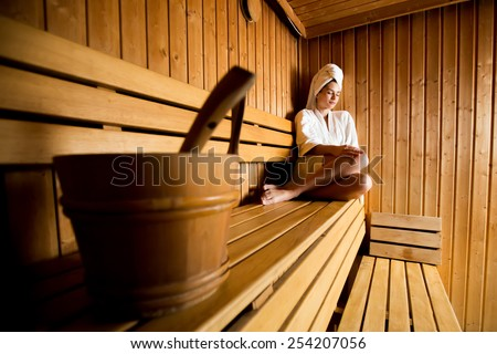 Young woman relaxing in the sauna - stock photo