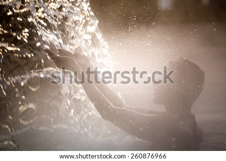 Young woman relaxing in thermal pool. - stock photo