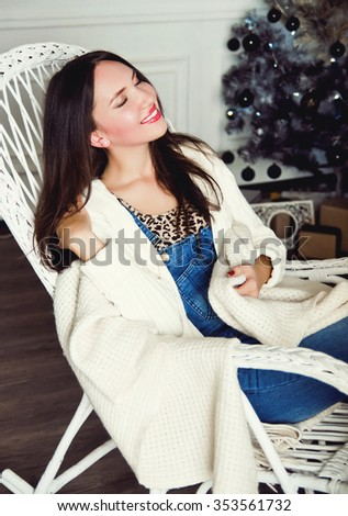 young woman relaxing near the Christmas tree