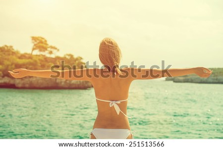 Young woman relaxing near the sea. Space for your text.v