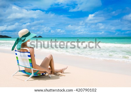 Young woman relaxing on a beautiful exotic beach. (location Hawaii)  - stock photo