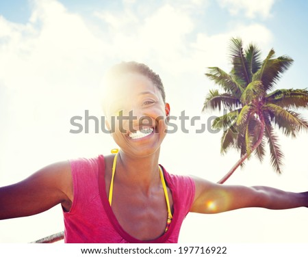 Young woman relaxing on a tropical beach. - stock photo