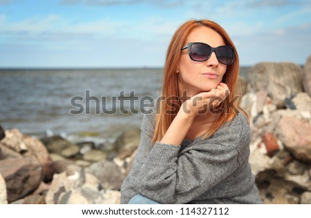 young woman relaxing on beach - stock photo