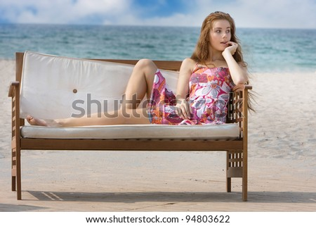 young woman relaxing on sea background - stock photo