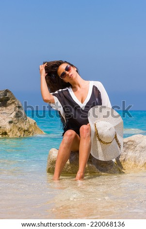 Young Woman relaxing on the beach - stock photo