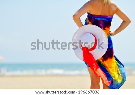 young woman relaxing on the beach in summer - stock photo