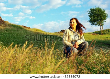 Young  woman relaxing on the meadow. - stock photo