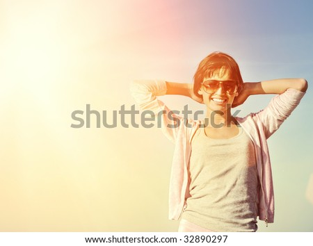 Young woman relaxing outdoors - stock photo