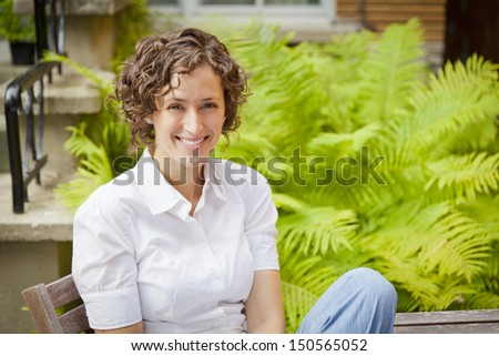Young Woman relaxing smiling - stock photo