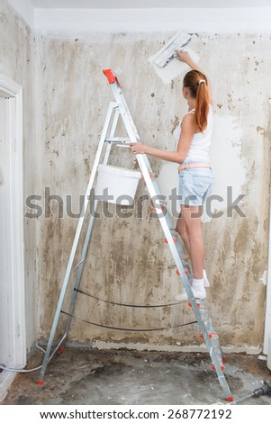 Young Woman repair her apartment