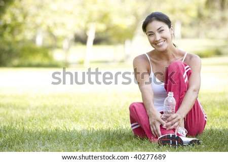 Young Woman Resting After Exercise - stock photo