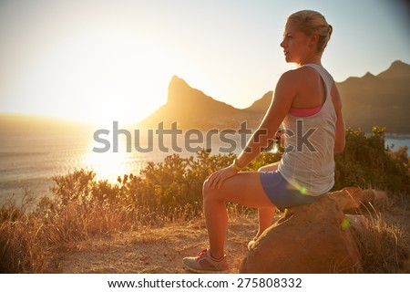 Young woman resting after jogging - stock photo