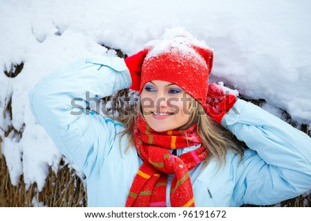 Young woman resting after winter activities outdoor.