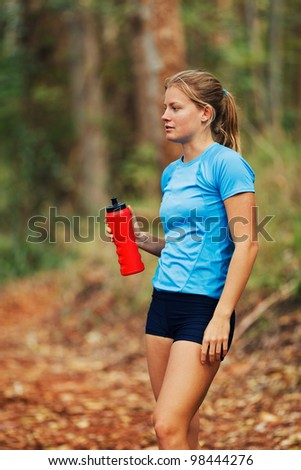 Young Woman Resting after Work Out Run - stock photo