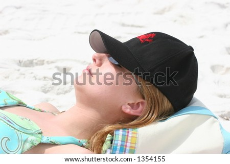 Young woman resting at beach.