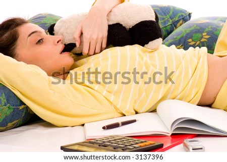 young woman resting from working in bed - stock photo