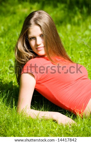 Young woman resting on a grass.