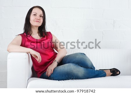 Young woman resting on sofa - stock photo