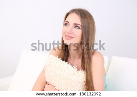Young woman resting on sofa at home