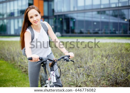 Young woman riding a bicycle in the city. The concept of an active way of life, sport and leisure