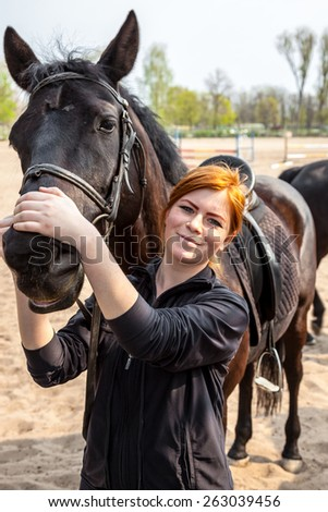 Young woman riding horse - stock photo
